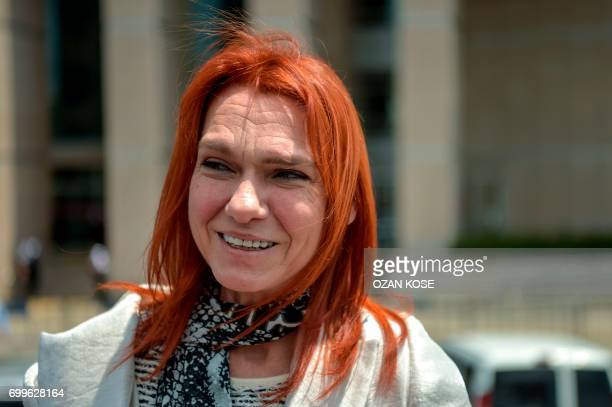 Turkish novellist Asli Erdogan talks to media on June 22 2017 in front of Istanbul's courthouse after her trial A Turkish court on June 22 2017...