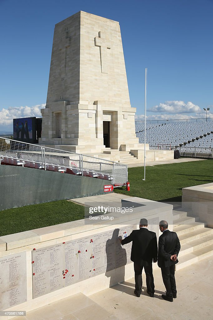Turkish officials look at the names of Australian soldiers killed during the Gallipoli Campaign at the Lone Pine monument ahead of commemoration...