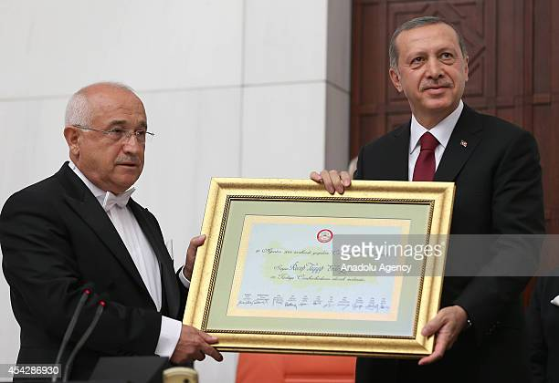 Turkish Parliament Speaker Cemil Cicek presents certificate of election to Turkish Presidentelect Recep Tayyip Erdogan during a presidential...