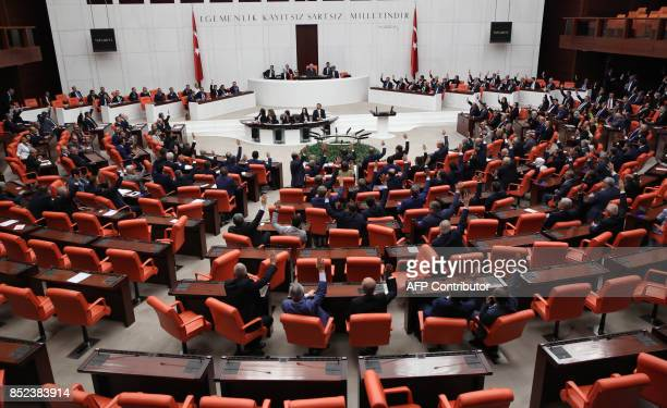 Turkish parliament votes during an emergency session to extend military operations in neighbouring Iraq and Syria at the Grand National Assembly of...
