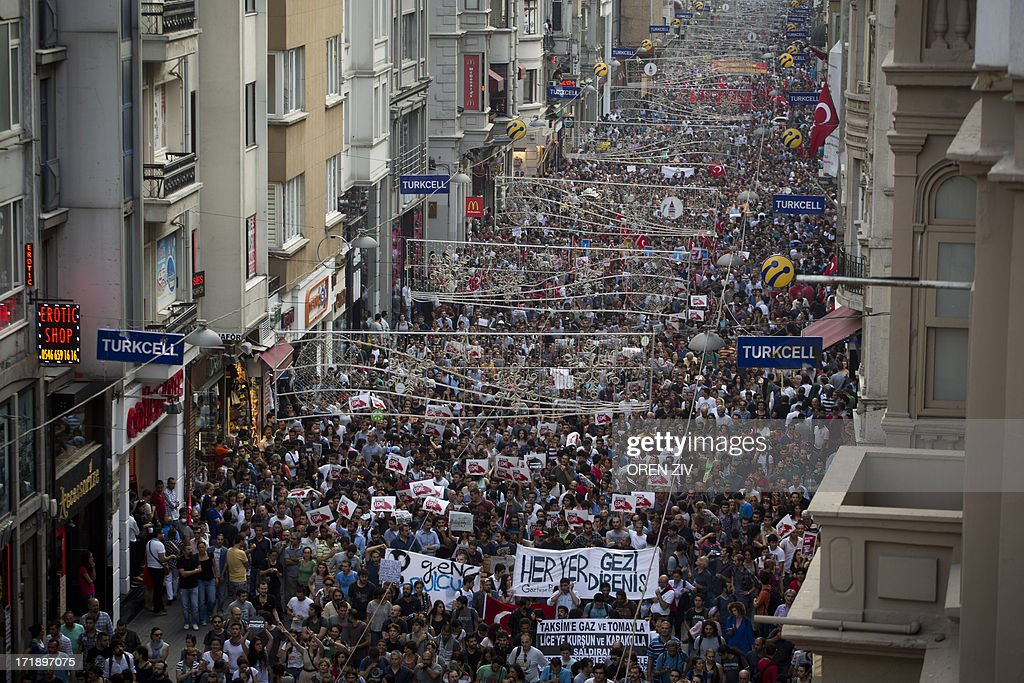 Turkish people gather during an anti-government protest on Taksim square in Istanbul on June 29, 2013. Protests initially sparked by a brutal police action against a local conservation battle to save Istanbul's Gezi Park snowballed into nationwide demonstrations against the Islamic-rooted government, leaving four dead and nearly 8,000 injured.