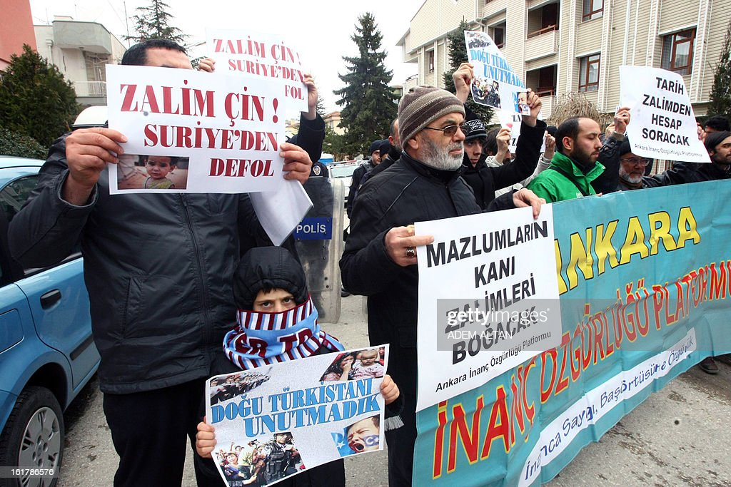 Turkish people hold signs reading '' 'Tyrant China, tyrant Assad,' and 'Tyrant China, get out of Syria!' as they protest against China's policies on Syria and its support to the regime of Syrian President Bashar al-Assad, in front of the Chinese embassy in Ankara, on February 16, 2013. China has backed Russia in supporting Syrian President Bashar Al-Assad, vetoing UN Security Council resolutions that would have put greater pressure on his regime. Beijing has also repeatedly urged dialogue to end the violence.