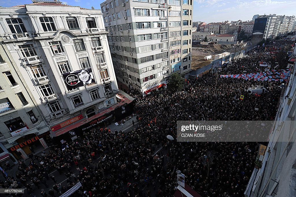 Turkish people march to the office of Armenian newspaper 'Agos' during a commemoration ceremony for slain journalist <a gi-track='captionPersonalityLinkClicked' href=/galleries/search?phrase=Hrant+Dink&family=editorial&specificpeople=741548 ng-click='$event.stopPropagation()'>Hrant Dink</a>, in Istanbul, on January 19, 2015. Turkish riot police were out in force on Monday as large crowds massed in Istanbul to demand justice for a prominent Turkish Armenian journalist murdered eight years ago. <a gi-track='captionPersonalityLinkClicked' href=/galleries/search?phrase=Hrant+Dink&family=editorial&specificpeople=741548 ng-click='$event.stopPropagation()'>Hrant Dink</a>, one of the most prominent voices of Turkey's shrinking Armenian community, was killed by a gunman on January 19, 2007. The 52-year-old Dink, a prominent member of Turkey's tiny Armenian community, campaigned for reconciliation but was hated by Turkish nationalists for calling the World War I massacres of Armenians a genocide. AFP PHOTO /OZAN KOSE