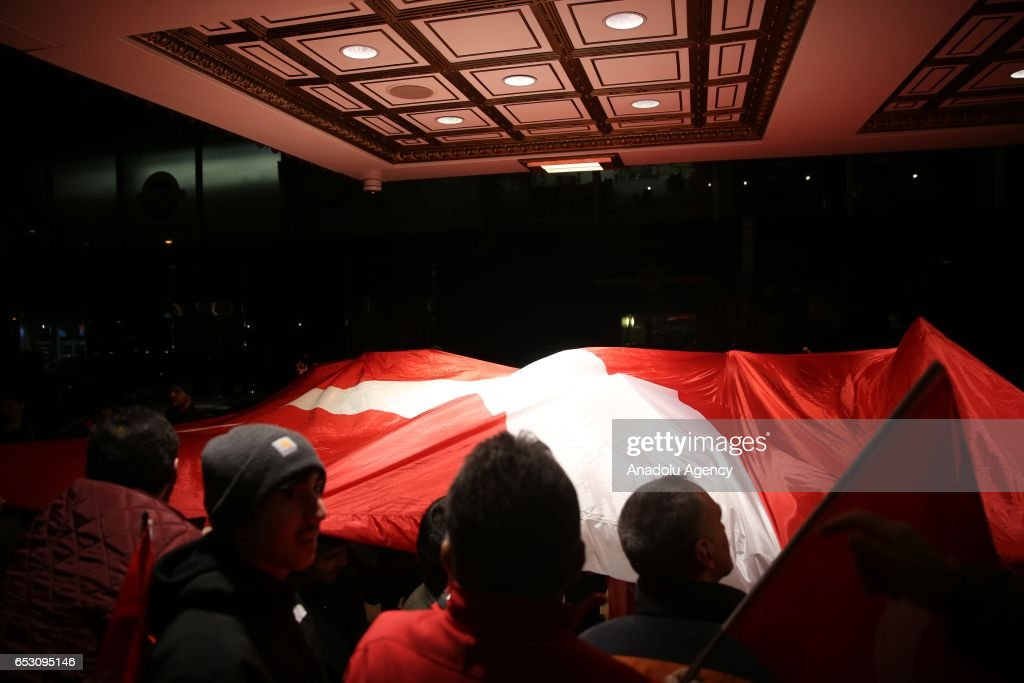 Turkish people show their support as they wait for the arrival of the Turkish family minister Fatma Betul Sayan Kaya (not seen) in Manhattan borough of New York, United States on March 13, 2017.
