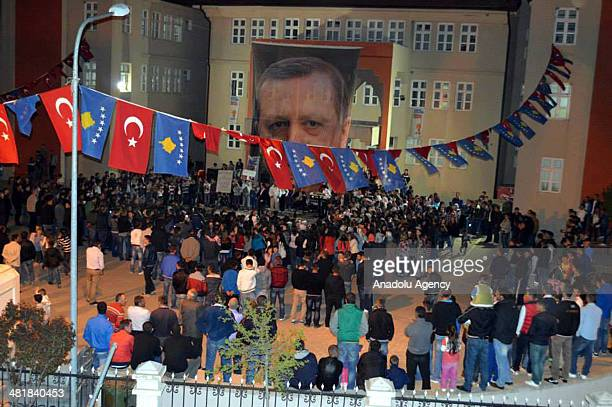 Turkish people who live in balkans hold poster of Turkish PM Recep Tayyip Erdogan and as they celebrate following the Turkish local elections in...