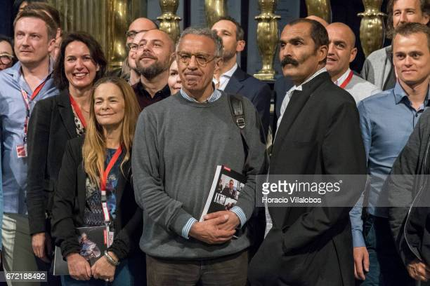 Turkish photojournalist Burhan Ozbilici winner of the World Press Photo of the Year is surrounded by other winners during the opening of the World...