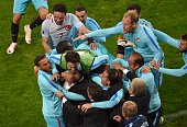 Turkish players celebrate after scoring their second goal during the Euro 2016 group D football match between Czech Republic and Turkey at...