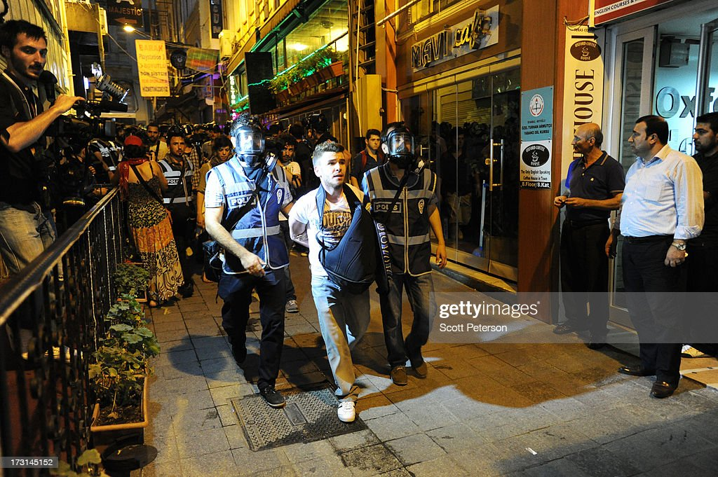 Turkish police arrest a man as they pursue anti-government protestors along the Istiklal shopping street near Taksim Square on July 8, 2013 in Istanbul, Turkey. The protests began in late May over the Gezi Park redevelopment project and saving the park trees adjacent to Taksim Square but swiftly turned into a protest aimed at Prime Minister Recep Tayyip Erdogan and what protestors call his increasingly authoritarian rule. The protest spread to dozens of cities in Turkey, in secular anger against Mr. Erdogan and his Islam-rooted Justice and Development Party (AKP).