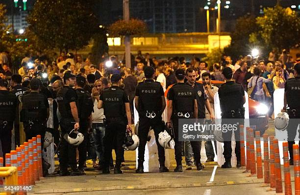Turkish police blocks the road as relatives of the passengers wait outside the Turkey's largest airport Istanbul Ataturk after the suicide bomb...