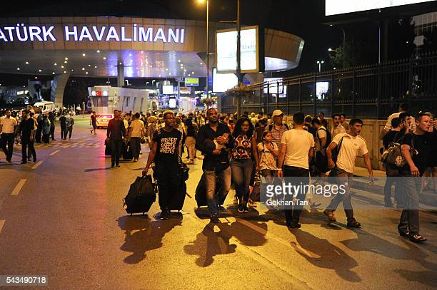 Turkish police blocks the roads as relatives of the passengers wait outside the Turkey's largest airport Istanbul Ataturk after the suicide bomb...