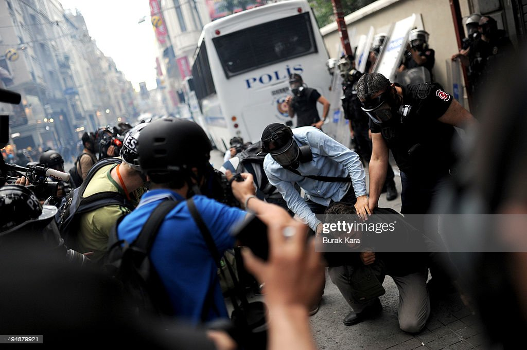 Turkish police detain a demonstrator during a protest in central Istanbul on May 31, 2014. Turkish police fired teargas and water cannon on Saturday to disperse protesters in central Istanbul who sought to mark the one-year anniversary of the country's biggest anti-government demonstrations in decades.