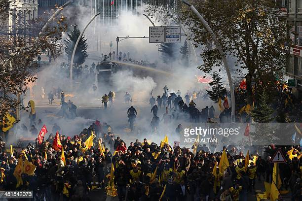 Turkish police fire tear gas and water cannon during a demonstration called by teachers unions against the government's education policies on...