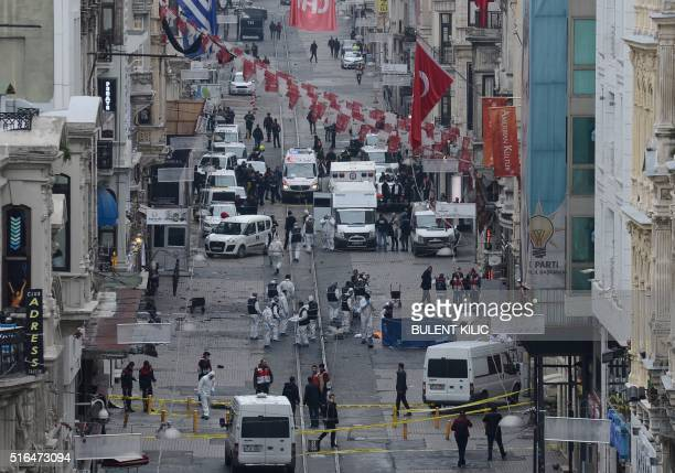 TOPSHOT Turkish police forensics and emergency services work on the scene of an explosion on the pedestrian Istiklal avenue in Istanbul on March 19...