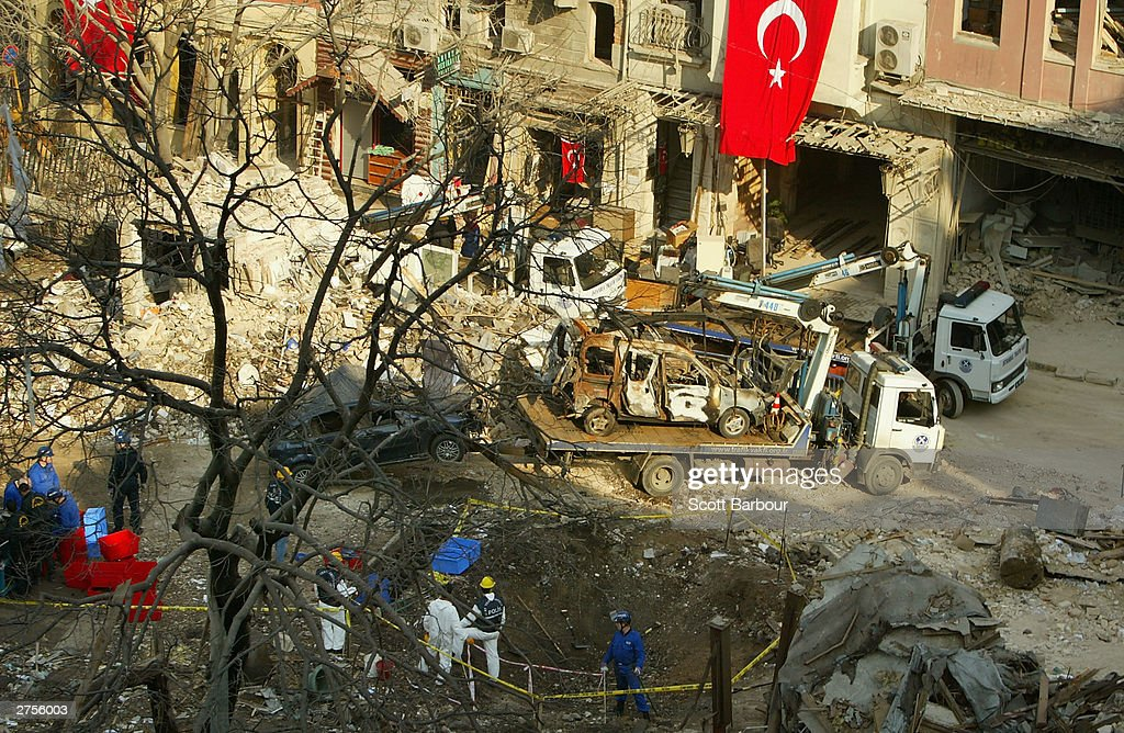 Turkish police forensics and workers search the remains of the damaged British Consulate November 23, 2003 in Istanbul, Turkey. Bomb attacks on the British consulate and the HSBC bank headquarters killed 27 people and left hundreds injured.