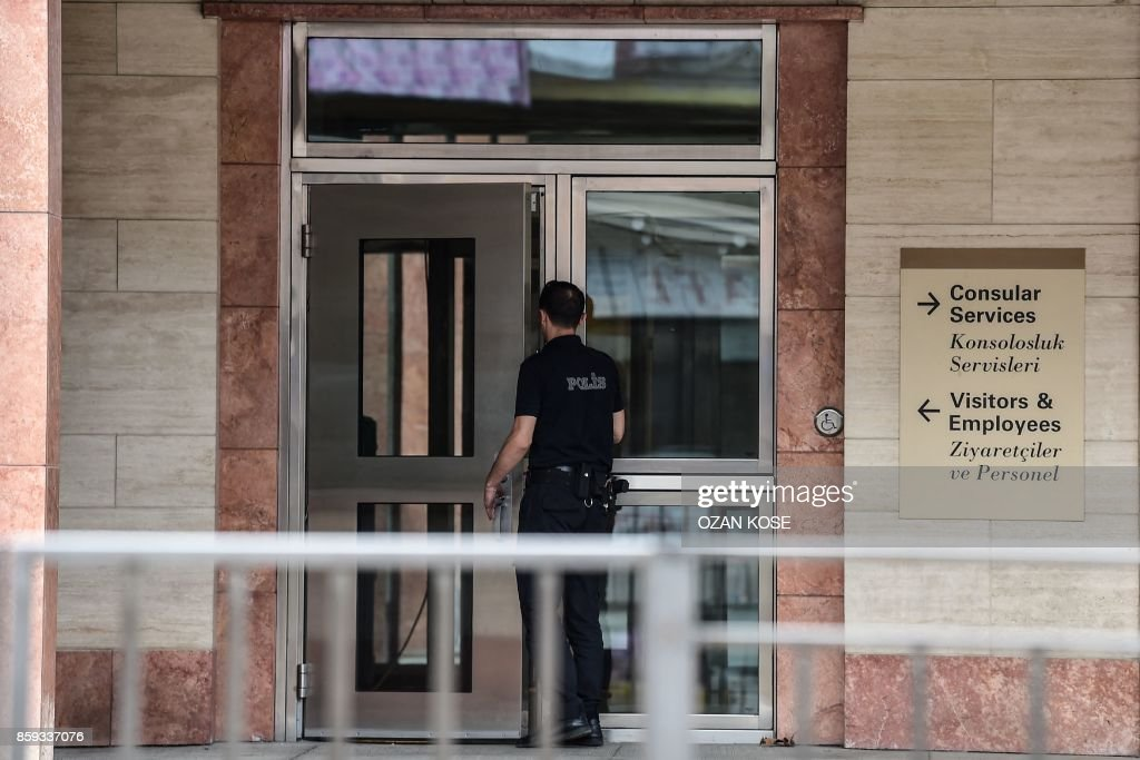 A Turkish police officer, patrols at the entrance of US consulate in Istanbul, on October 9, 2017. Turkey on October 9, 2017 urged the United States to reverse a decision to halt the issuing of all regular visas at American consulates in the country, in a row that risks a major crisis. Ankara hit back at the US move -- sparked by the arrest of an Istanbul consulate staffer -- with a similar halt by Turkey's missions in the US. Analysts warned the dispute risked becoming the most serious row between the two NATO allies in decades. /
