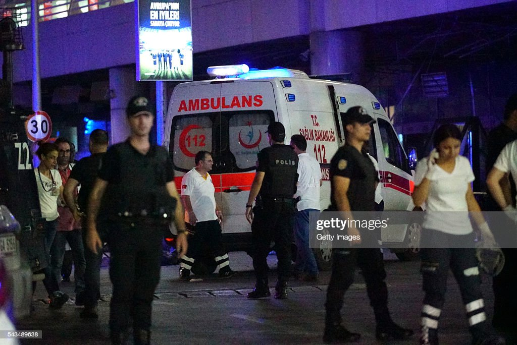 Turkish police officers and medics gather outside Turkey's largest airport, Istanbul Ataturk, after it was hit by a suicide bomb attack on June 28, 2016, Turkey. Three suicide bombers opened fire before blowing themselves up at the entrance to the main international airport in Istanbul, killing at least 28 people and wounding at least 60 people according to Justice Minister Bekir Bozdagç.