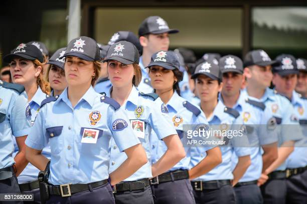 Turkish police officers attend the funeral ceremony of Turkish police officer Sinan Acar killed last night at Istanbul's police department...