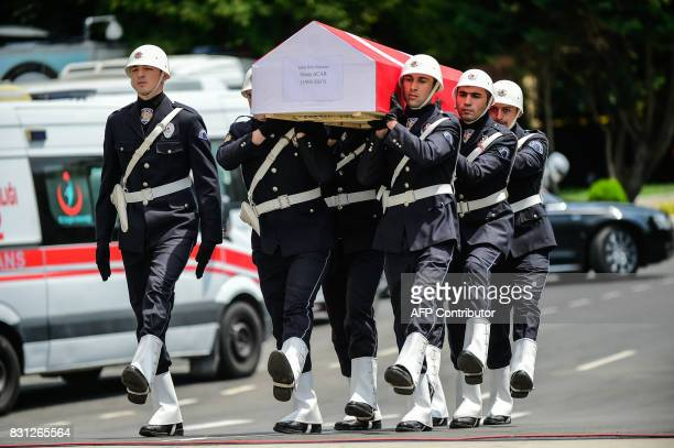 Turkish police officers carry the coffin of killed police officer Sinan Acar on August 14 2017 during his funeral cerenomy at Istanbul's police...