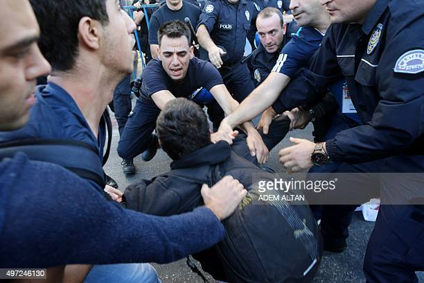 Turkish police officers clash with protestors during a protest against the G20 Summit in Antalya on November 15 2015 Leaders from the world's top 20...