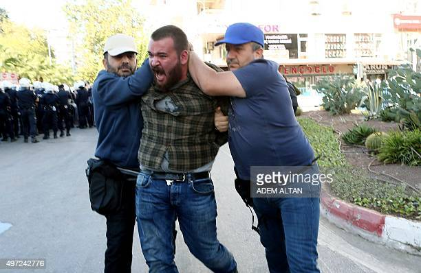 Turkish police officers detain a protestor during a protest against the G20 Summit in Antalya on November 15 2015 Leaders from the world's top 20...