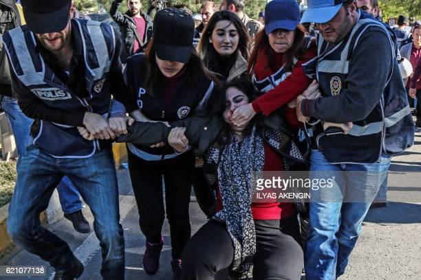 TOPSHOT Turkish police officers detain former proKurdish Peoples' Democracy Party parliamentarian Sebahat Tuncel on November 4 2016 during a...