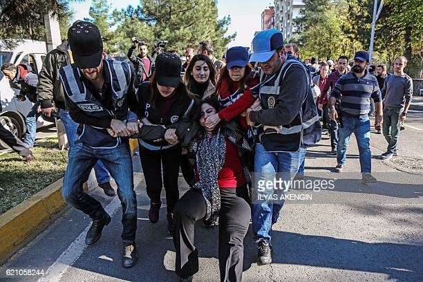 TOPSHOT Turkish police officers detain Sabahat Tuncel former Pro Kurdish People's Democracy Party member of the Parliament on November 4 2016 at...