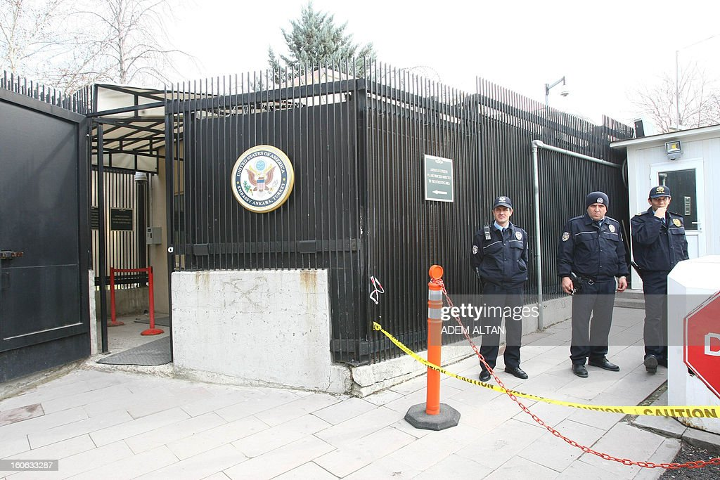 Turkish police officers guard on February 4, 2013 near the side entrance of the US Embassy in Ankara after a suicide bomber blew himself up on February 1 outside the facility. A radical Turkish Marxist group, the Revolutionary People's Liberation Front (DHKP-C), claimed responsibility for the bomb attack at the embassy, where a Turkish security guard was killed.