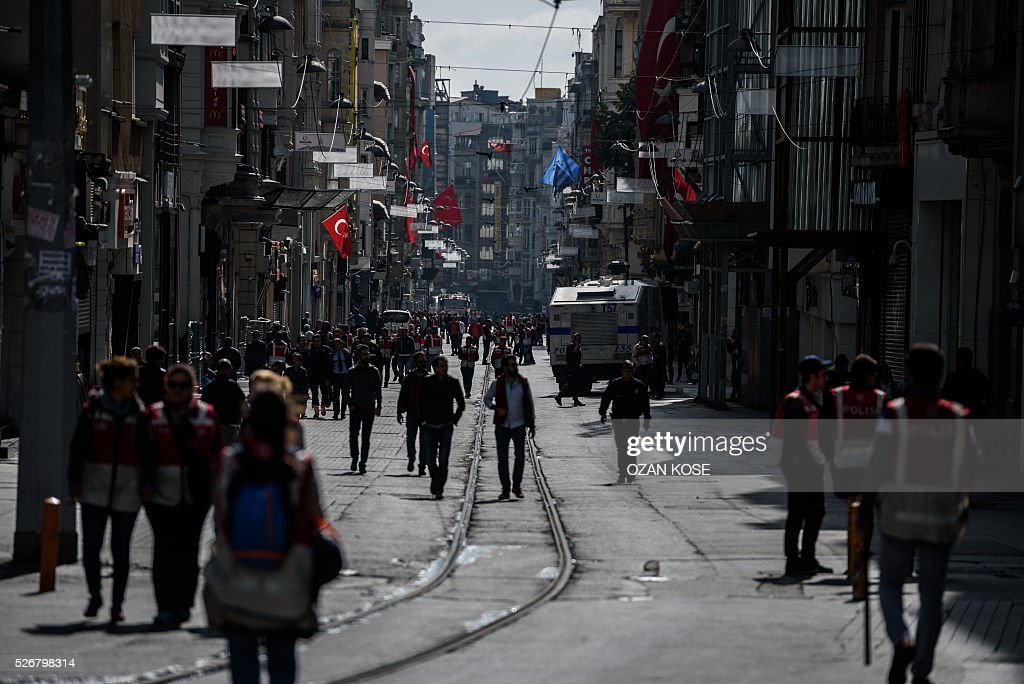Turkish police officers patrol on Istiklal avenue during a May Day rally in Istanbul, on May 1, 2016. Turkish labour activists and leftists marked the annual May Day holiday, with thousands of security deployed and bracing for trouble after the authorities refused to allow protests in central Taksim Square. / AFP / OZAN