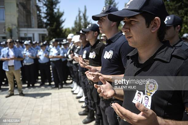 Turkish police officers pray during the funeral of two police officers on July 23 in Sanliurfa after they were found shot dead at their home in the...