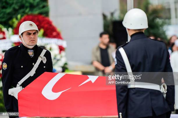 Turkish police officers stand next to the coffin of killed police officer Sinan Acar on August 14 2017 during his funeral cerenomy at Istanbul's...