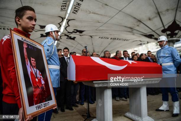Turkish police officers stand next to the coffin of Turkey's legendary triple Olympic goldmedal winning weightlifter Naim Suleymanoglu during his...