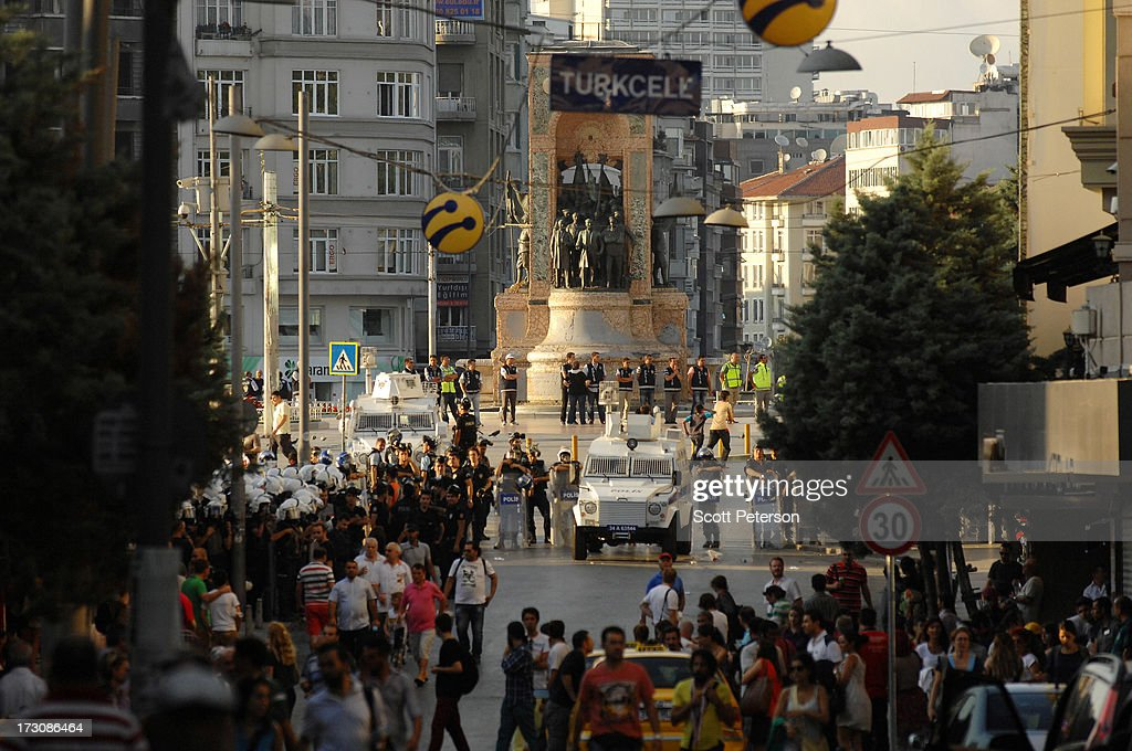 Turkish police secure Taksim Square and a statue to the father of modern Turkey Mustafa Kemal Ataturk as they prepare to use tear gas and water cannons to battle anti-government protestors on July 6, 2013 in the heart of Istanbul, Turkey. The protests began in late May over the Gezi Park redevelopment project and saving the park trees adjacent to Taksim Square but swiftly turned into a protest aimed at Prime Minister Recep Tayyip Erdogan and what protestors call his increasingly authoritarian rule. The protest spread to dozens of cities in Turkey, in secular anger against Erdogan and his Islam-rooted Justice and Development Party (AKP).