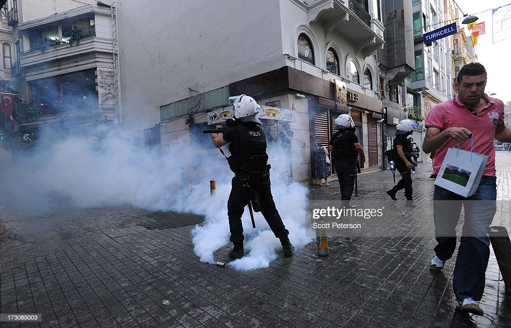 Turkish police use tear gas and water cannons to battle antigovernment protestors along the Istikhlal shopping avenue near Taksim Square on July 6...