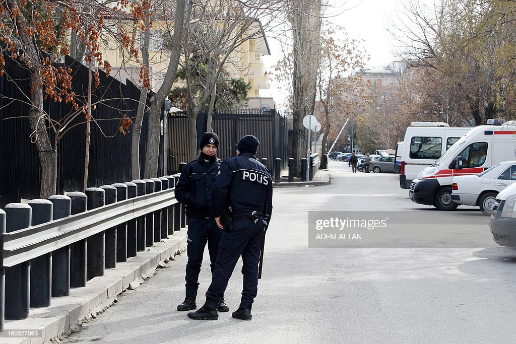 Turkish policemen patrol outside the US Embassy in Ankara, a day after a leftist suicide bomber in Ankara, on February 2, 2013. Two security guards were killed in the blast outside the US embassy, local television reported, amid speculation it was a suicide attack. The force of the explosion damaged nearby buildings in the Cankaya neighborhood where many other state institutions and embassies are also located.