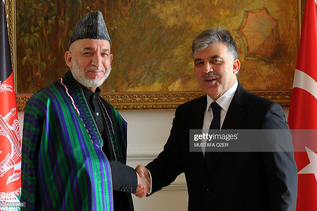 Turkish President Abdullah Gul (R) and his Afghan counterpart Hamid Karzai shake hands on November 1, 2011 before their meeting in Istanbul ahead of a trilateral summit between Turkey, Afghanistan and Pakistan. Turkey is holding the summit in a bid to reduce tensions between the two neighbors and forge a new period of cooperation. AFP PHOTO / MUSTAFA OZER