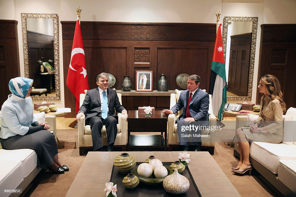 Turkish President <a gi-track='captionPersonalityLinkClicked' href=/galleries/search?phrase=Abdullah+Gul&family=editorial&specificpeople=539775 ng-click='$event.stopPropagation()'>Abdullah Gul</a> and his wife Hayrunnisa Gul are received by Jordan's King Abdullah and his wife Queen Rania upon their arrival for a three-day official visit in Amman on December 1, 2009 in Amman, Jordan.