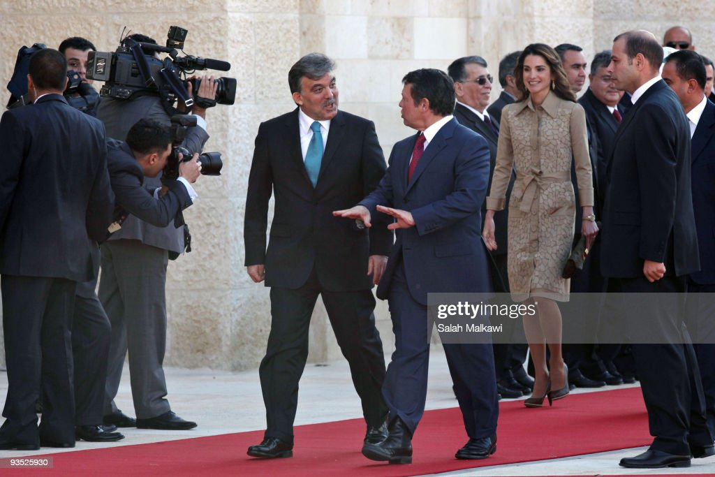Turkish President Abdullah Gul and his wife Hayrunnisa Gul are received by Jordan's King Abdullah and his wife Queen Rania upon their arrival for a three-day official visit in Amman> on December 1, 2009 in Amman, Jordan.