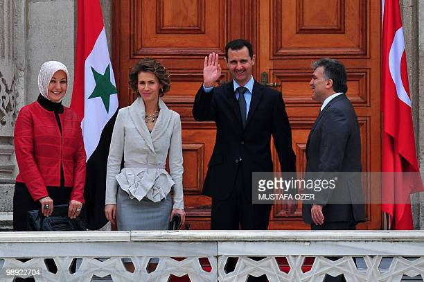 Turkish President Abdullah Gul and Syrian President Bashar alAssad pose with their wives Hayrunnisa Gul and Asma during a welcoming ceremony in...