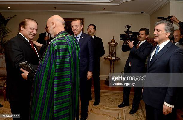 Turkish President Abdullah Gul and Turkish Prime Minister Recep Tayyip Erdogan look on as Afghan President Hamid Karzai and Pakistani Prime Minister...