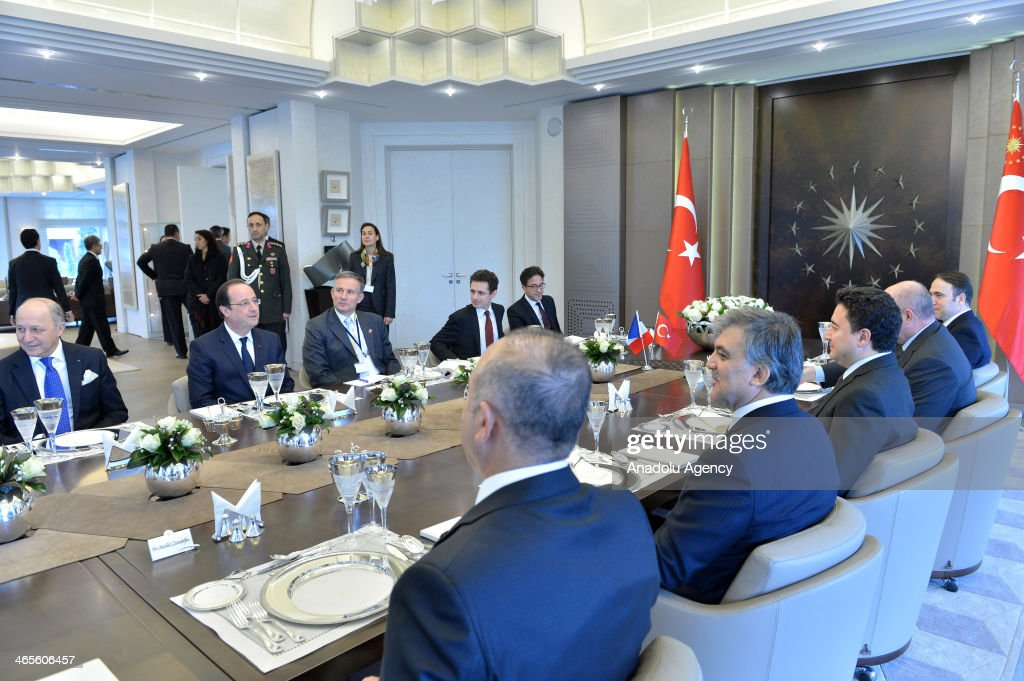 Turkish President Abdullah Gul (5th R) hosts a dinner in honor of French President Francois Hollande (2nd L) at Tarabya Palace in Istanbul, Turkey, on January 28, 2014. The meeting was held closed to press at the Tarabya Palace in Istanbul.