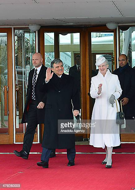 Turkish President Abdullah Gul is welcomed by Queen Margrethe II of Denmark at Copenhagen Airport in Copenhagen Denmark on March 17 2014