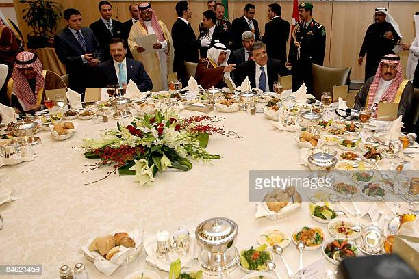Turkish President Abdullah Gul listens to Saudi minster of state Abdulallah Zainal during a Business Forum lunch in Riyadh on February 4 2009 Gul is...