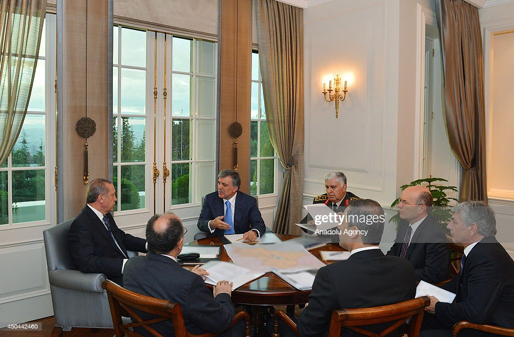 Turkish President Abdullah Gul (Rear 2nd L) Prime Minister Recep Tayyip Erdogan (L), Chief of General Staff General Necdet Ozel (Rear 3rd L), Deputy Prime Minister Beshir Atalay (Front 2nd L), Deputy Foreign Minister Naci Koru (2nd R), Deputy Counselor of Prime Minister Omer Onhon (R) and the National Intelligence Organization Undersecretary Hakan Fidan (front R) attend the emergency summit at the Cankaya Presidential Palace in Ankara, Turkey on June 11, 2014, following the attack on the Turkish Consulate in the northern Iraqi city of Mosul by militants of the Islamic State in Iraq and the Levant (ISIL).
