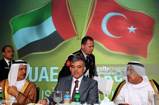 Turkish President Abdullah Gul sits between Abdul Rahman Saif alGhurair Chairman of Dubai Chamber of Commerce and Sultan alMansoori UAE Minister of...