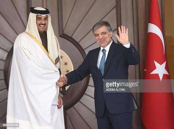 Turkish President Abdullah Gul welcomes Qatar's Emir Sheikh Tamim bin Hamad alThani before a meeting in Ankara Turkey on February 14 2014 AFP PHOTO /...