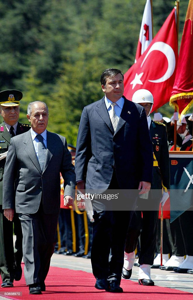 Turkish President Ahmet Necdet Sezer (L) and his Georgian counterpart Mikhail Saakashvili (R) review an honour guard before their meeting during Saakashvili`s first official visit to Turkey after peacefully overthrowing former leader Eduard Shevardnadze last year, Ankara, 20 May 2004.