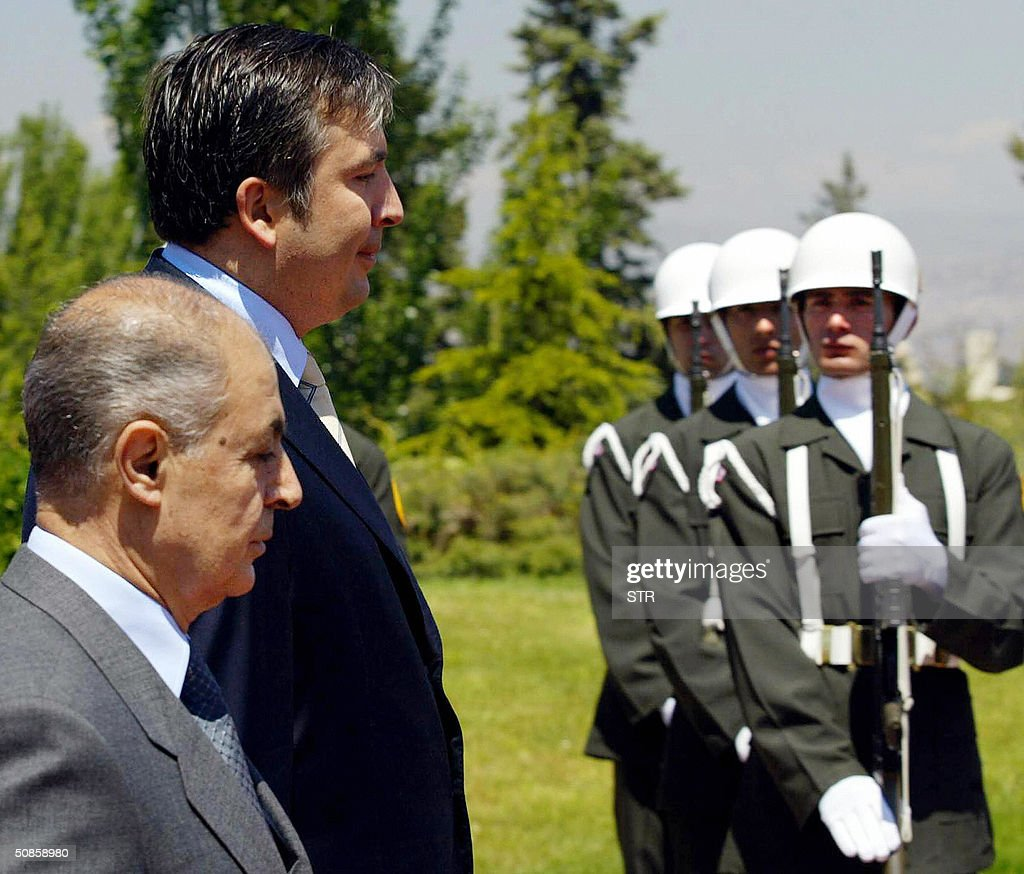 Turkish President Ahmet Necdet Sezer (L) and his Georgian counterpart Mikhail Saakashvili (R) review an honor guard before their meeting during Saakashvili`s first official visit to Turkey after peacefully overthrowing former leader Eduard Shevardnadze last year, Ankara, 20 May 2004.