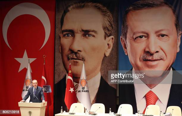 Turkish President and ruling Justice and Development Party chairman Recep Tayyip Erdogan delivers a speech during the AK Party's provincial meeting...