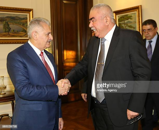 Turkish President Binali Yildirim meets Afghan vicepresident Abdul Rashid Dostum in Ankara Turkey on August 01 2016