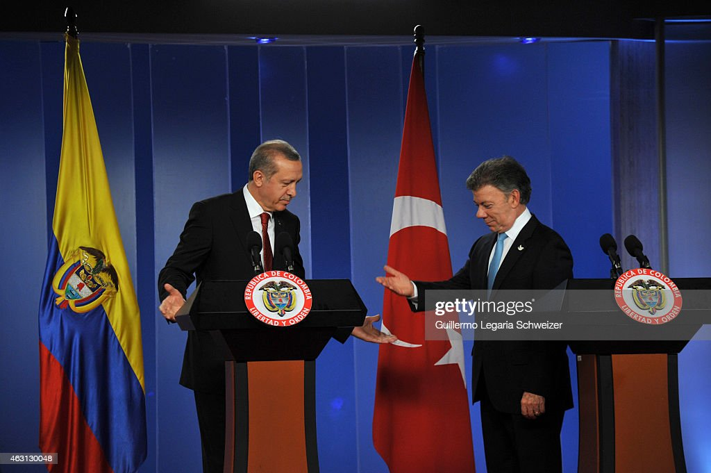 Turkish president Recep Tayyip Erdoga (L) and Colombian president <a gi-track='captionPersonalityLinkClicked' href=/galleries/search?phrase=Juan+Manuel+Santos&family=editorial&specificpeople=974752 ng-click='$event.stopPropagation()'>Juan Manuel Santos</a> gesture during a joint press conference after a meeting at Narino Presidential palace on February 10, 2015 in Bogota, Colombia. Turkish president is on a two day official visit to Colombia.